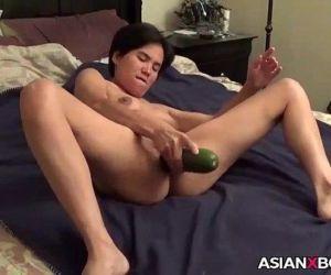 Asian MILF inserts a..