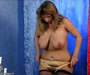 Busty mature rubbing..