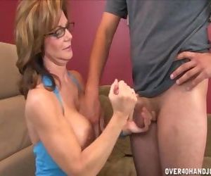 Mature Lady Strokes A..