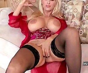 Horny big-tit MILF slut..
