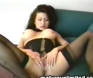 Big breasted milf plays..