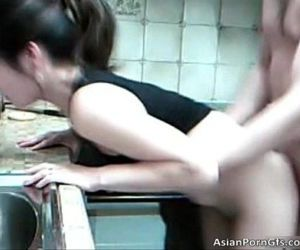 Cute asian babe getting..