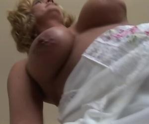 Busty mature blonde..
