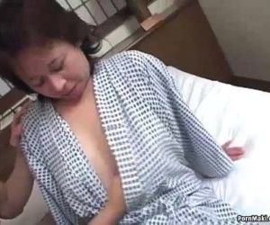 Asian granny enjoys..