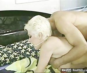 Busty blonde milf..